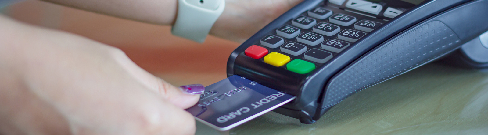 Person making a purchase with a debit card