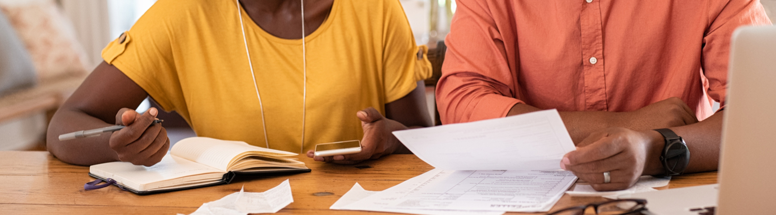 Black couple looking at paperwork