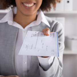 Black woman holding a cashiers check