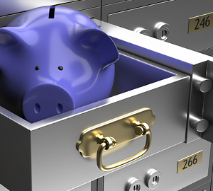 Safe deposit boxes with a blue piggy bank in one of the drawers.