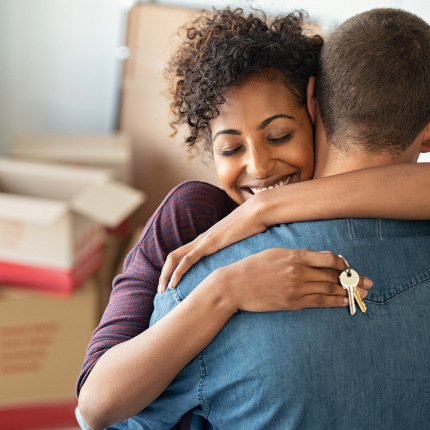 New homeowners hugging